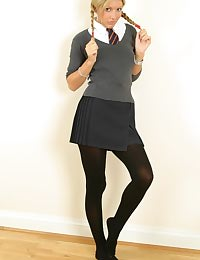 Sexy blonde Nicole in college uniform with opaque tights