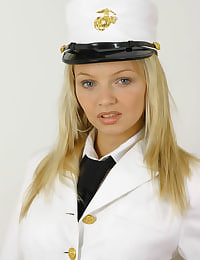 Sexy blonde Sam in pilots uniform with stockings