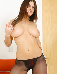 Extremely busty Emma in tight top and pantyhose