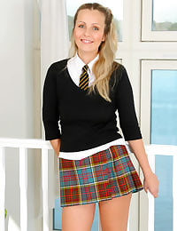 Natasha in college uniform with grey knee socks