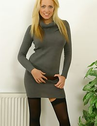 Amazing blonde in a grey jersey dress