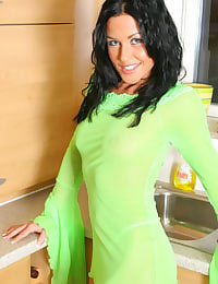 Lolly in bright green outfit with fishnet holdups