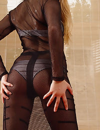 Ruth in fishnet dress and black tights