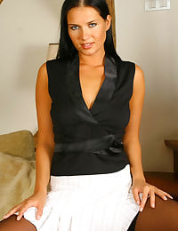 Denisa dressed smartly in a slender black top and stylish white skirt.