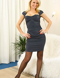 Beautiful blonde ready for a night out in a slinky dress and stockings.