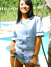 Penelope the dark haired beauty in a nurse uniform with sexy white lingerie and black stockings.