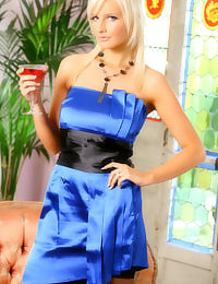 Blonde beauty Michelle Marsh in a sexy blue evening dress.