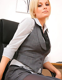 Beauty secretary removes her clothes in the office.