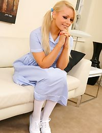 Stunning blonde Melissa slips out of her sexy college uniform.