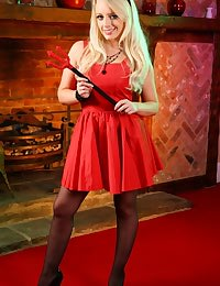 Busty blonde in a devilishly naughty red minidress.