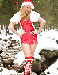 Beautiful Santa Claus girl seductively removes her sexy outfit.
