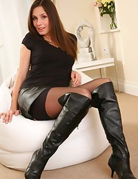Lola wearing a tight black top and a leather miniskirt.
