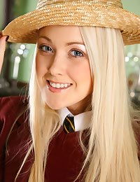 Blonde beauty Lucy dressed up as a naughty college girl.