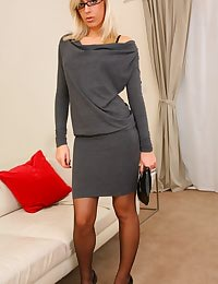 Beauty secretary looks stunning in minidress and stockings.