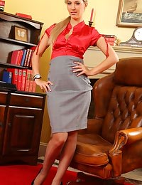 Hot blonde secretary in a red silk blouse and tight grey pencil skirt.