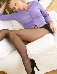 This saucy secretary Nikki F slowly escapes from her purple shirt and short black miniskirt