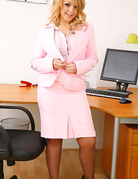 Busty office girl Cherry D undresses in her office chair to reveal her beautiful lingerie and grey stockings