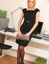 Natasha appears to be the perfect secretary in her black minidress and stockings.