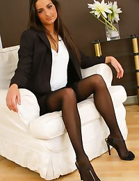 Gorgeous brunette Isla looks stunning in her sexy brown secretary outfit