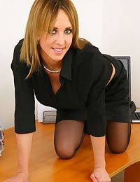 Blonde secretary slips out of skirt and sexy lingerie.