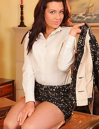 Jessica looks pretty and proffesional in her miniskirt suit and pantyhose.