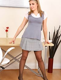 Naomi strips out of her grey secretary skirt and top to reveal her perfect body.