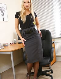 Michelle seductively removes secretary outfit revealing sexy black lingerie.