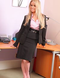 Michelle X in a sexy black skirt suit and pink blouse with matching pink stockings.