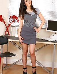 Brunette looks absolutely fantastic in an all grey secretary outfit.