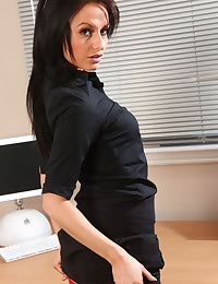 Raven haired secretary pleases her boss by slipping out of her work clothes.