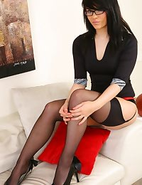 Laura wearing a tight top and tight black skirt.