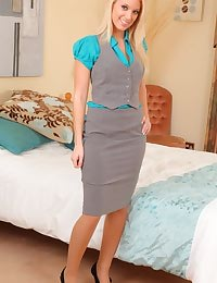 Sexy blonde secretary pleases her boss in her tight grey skirt suit and and beige pantyhose.