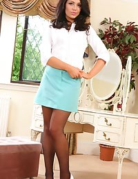 Raven haired secretary resides to her bedroom after a hard day in the office and undresses to reveal her gorgeous body.