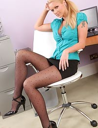 Jessica Roe unbuttons her blouse and slips off the tight miniskirt to show a teasing strip.
