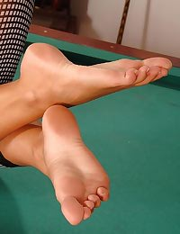 Blonde playing feet-pool