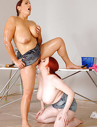 Two busty lesbos having fun