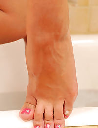 Barefoot babes in the bath tub