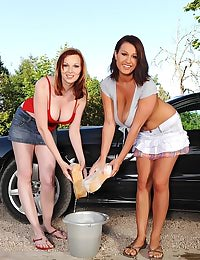 Hot busty babes washing car