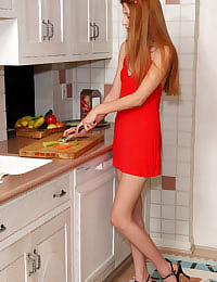 Red-Headed Rita Lovely in Kitchen with her shaved pussy