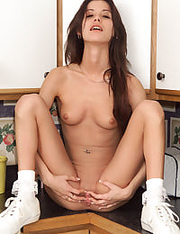 Amy Lee Spreads Wide in the Kitchen with her shaved pussy