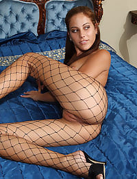 Anita Pearl in Fishnets Stuffs Panties  with her shaved pussy