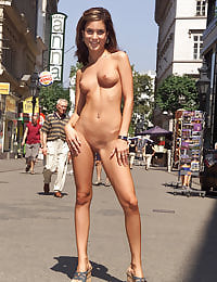 Nella Nude in Public with her shaved pussy