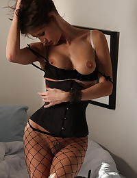 Jenni Lee in is a wild brunette with black fishnets and a corset