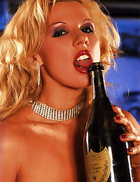A Go Go Girl having a sexy messy of champagne