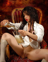 A horny brunette enjoying a jar of beer in stockings with some pee fetish play