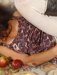 A horny hairy gal in white tights plays in a dirty way with an apple and a zucchini