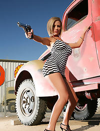 Tatoo Bitch with Gun Outdoors