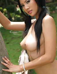 Busty Thai Girl Nancy Ho Strips In Pigtails