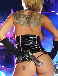 Slutty Police Officer in Latex with Gun