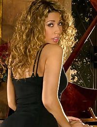 Latina Secretary with Curly Hair at Piano